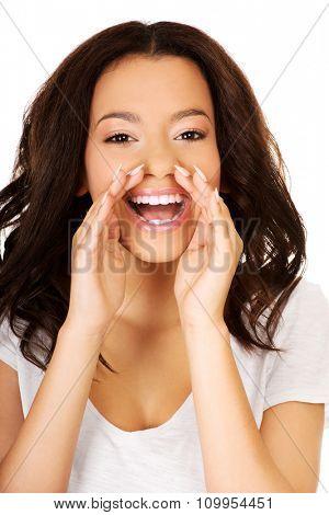 Teen african woman whispering gossip.