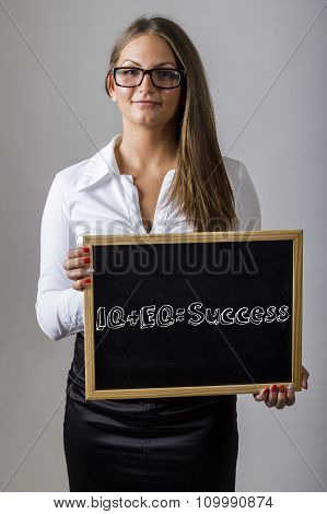 Iq + Eq = Success - Young Businesswoman Holding Chalkboard With Text