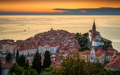 Sunset Over Adriatic Sea and Picturesque Old Town of Piran Slovenia. Aerial View. poster