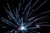 Exploding fireworks against the dark of night sky poster