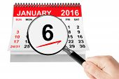 Epiphany Day Concept. 6 January 2016 calendar with magnifier on a white background poster