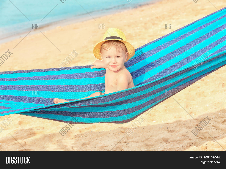 Cute Baby Boy In Hammock On Beach