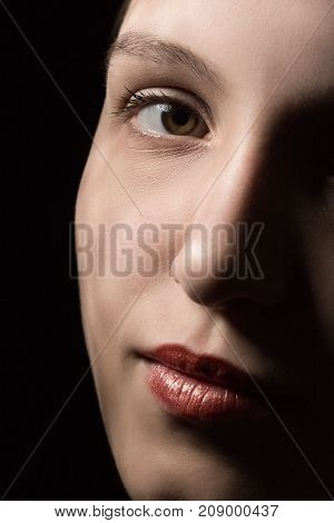 beautiful female portrait with professional makeup on black background