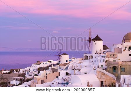 view of Oia village  at the Santorini Island at sunset