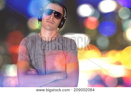 man enjoying his favorite music in headphones with bokeh background