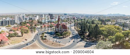WINDHOEK NAMIBIA - JUNE 17 2017: An aerial panorama of the Christuskirche Tintenpalast and part of the central business district of Windhoek the capital city of Namibia