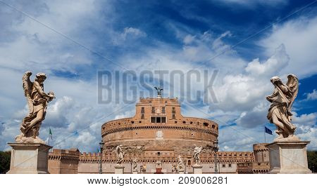 ROME, ITALY - SEPTEMBER 18: Tourists visit Castel Sant'Angelo (Castle of the Holy Angel) in the center of Rome with beautiful baroque angel statues and clouds SEPTEMBER 18, 2016 in Rome, Italy
