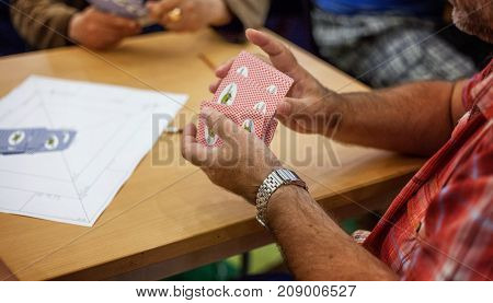 close up view of cards in hands