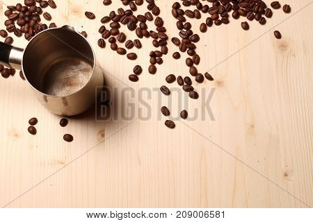 Coffee beans scattered on a wooden table