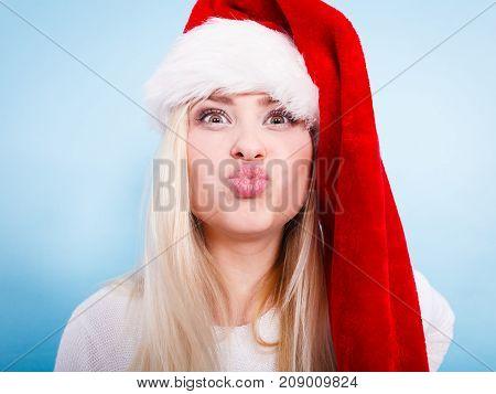 Woman Wearing Santa Claus Hat Making Faces