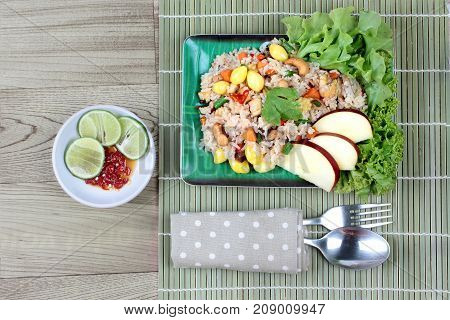 Vegetable festival of Chinese Fried rice with mixed vegetable and side dish as slide lemon chiki in soy sauce.