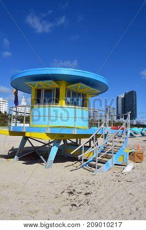 Circular ocean-rescue station on the beach in Miami Beach,Florida with Miami Beach condo skyline in the background.