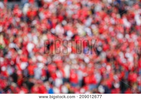 Blurred fans in sporting event stands