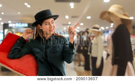 Woman With Shopping Bag Pointing Finger.
