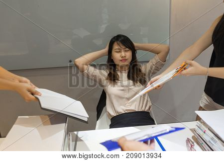 Asian manager too exhausted and headache, she doesn't want to hear any reports from employees