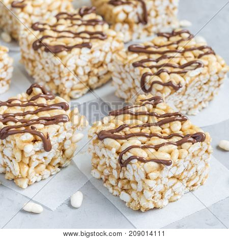 Homemade three ingredients bars with crispy rice honey and peanut butter square format