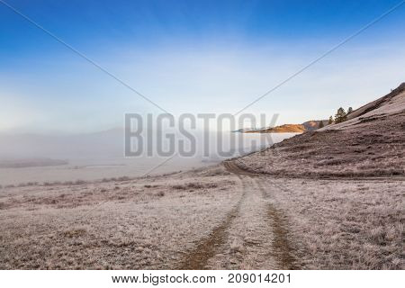 Country Road in a fog in the mountains of Altai. Siberia.