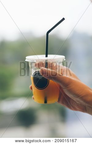 A man's hand with orange juice, A healthy diet
