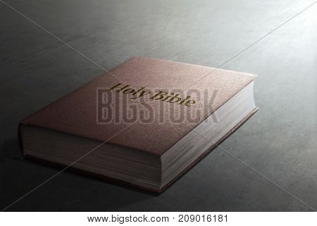 Image of Holy Bible on gray background