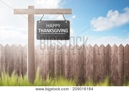 Wooden Fence And Grass With Happy Thanksgiving Message On Signboard