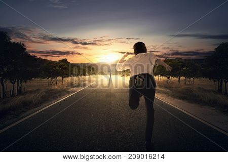 Man Running Chasing Cross At The End Of The Road