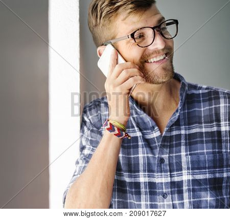 Young Man Smiling Talking Smartphone Concept