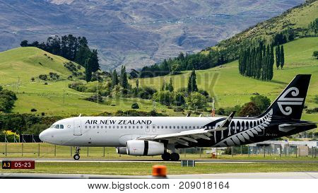 Airplane Of Air New Zealand Takes Off From Airport