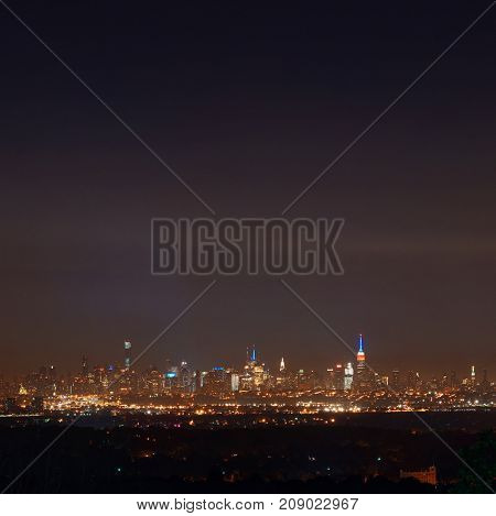 New York City skyline at night with midtown skyscrapers