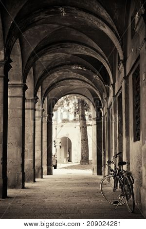 Lucca street view with bike in hallway in Italy