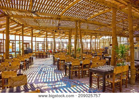 Sharm El Sheikh, Egypt - September 24, 2017: Outdoor restaurant and beach at the luxury hotel at Sharm el Sheikh, Egypt on September 24, 2017