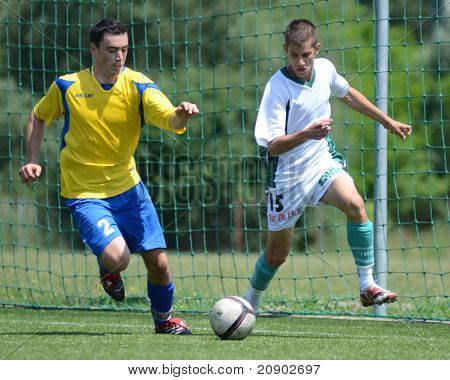 KAPOSVAR, HUNGARY - JUNE 11: Erik Judak (L) in action at the Hungarian National Championship under 13 game between Kaposvari Rakoczi FC and Bajai LSE June 11, 2011 in Kaposvar, Hungary.