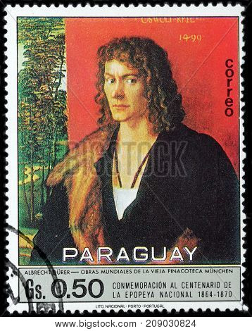 LUGA RUSSIA - OCTOBER 6 2017: A stamp printed by PARAGUAY shows Portrait of Oswald Krel by Albrecht Durer - a painter printmaker and theorist of the German Renaissance circa 1970