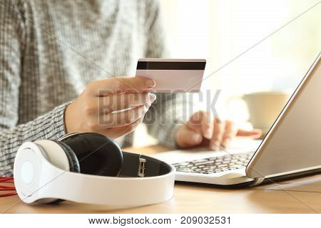 On Line Buyer Buying Music With A Laptop