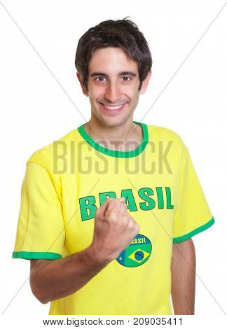 Brazilian man with short black hair showing fist on an isolated white background for cut out