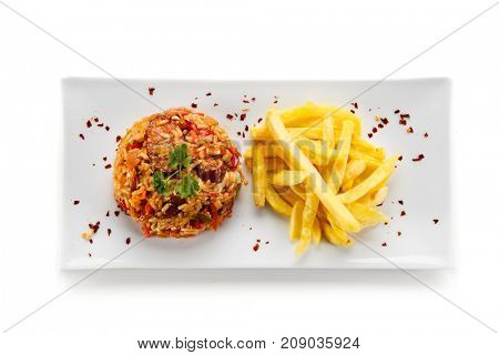 Chicken meat with rice and chips