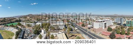 WINDHOEK NAMIBIA - JUNE 17 2017: An aerial panorama of the southern parts of Windhoek the capital city of Namibia. Windhoek High School and the Alte Feste is visible to the left