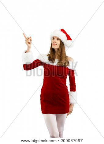 Beautiful woman in Santa Claus clothes pointing on white background