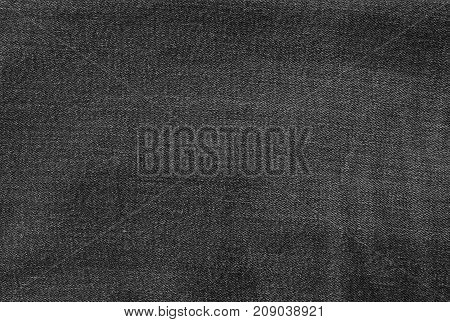 Fabric Texture Close Up Black Denim Jean Texture Pattern Background.