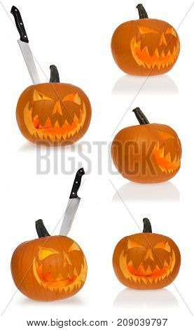 Halloween Scary Pumpkin Lights From Inside With A Stabbed Knife.