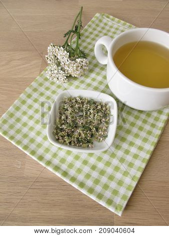 Cup of herbal tea with dried yarrow