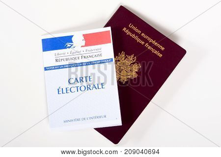 a french passport and voting card isolated on the white background