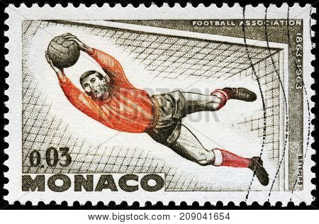 LUGA RUSSIA - OCTOBER 6 2017: A stamp printed by MONACO shows football goalkeeper in action circa 1963