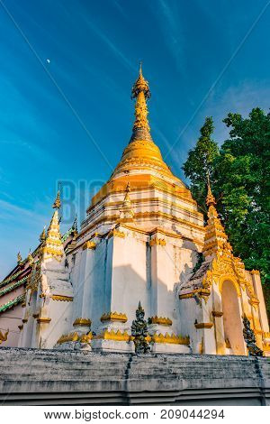 Stupa of a Buddhist temple against blue sky, Chiang Mai, Thailand
