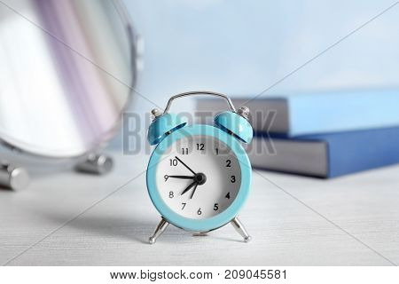 Alarm clock on table in bedroom. Morning routine concept