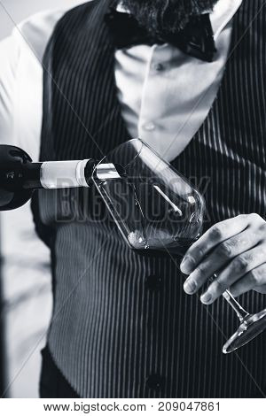 Pouring Red Wine From Bottle, Black And White Image