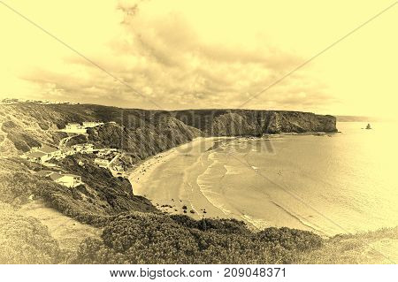 Sandy Beach on the Rocky Coast of Atlantic Ocean in Portugal Stylized Photo