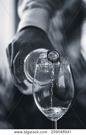 Pouring White Wine From Bottle, Black And White