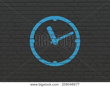 Time concept: Painted blue Clock icon on Black Brick wall background