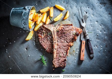 Yummy Tbone Steak And Chips With Salt And Rosemary