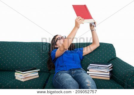 Student Girl Sitting On Couch Studying From Notebook